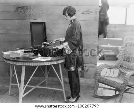 Woman playing record - stock photo