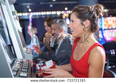woman playing slot machines in the excalibur hotel and casino