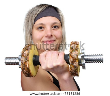 woman playing sports with pineapple dumbbells - stock photo