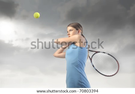 Woman playing tennis - stock photo