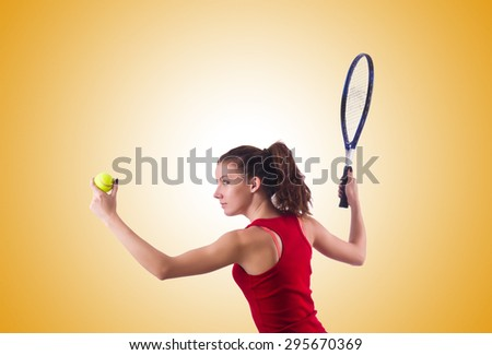 Woman playing tennis against the gradient - stock photo