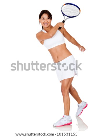 Woman playing tennis hitting the ball - isolated over a white background - stock photo