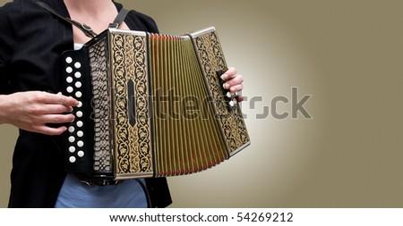 Woman playing traditional accordion - stock photo