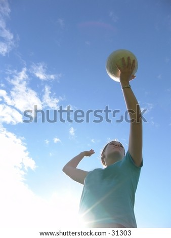 Woman playing volleyball. - stock photo