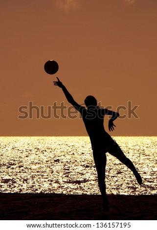 Woman playing volleyball on the beach, Miami, Miami-Dade County, Florida, USA - stock photo