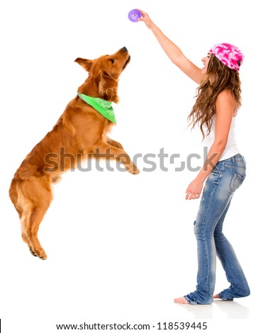 Woman playing with her dog - isolated over a white background - stock photo