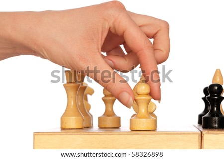 woman plays chess and chooses for victory next pawn move - stock photo