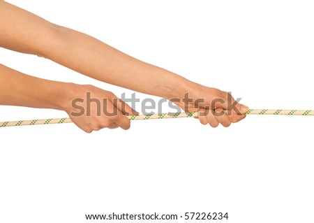 woman plays of pulling of a rope and wins - stock photo