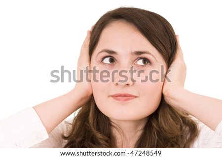 Woman plugging her ears over white background