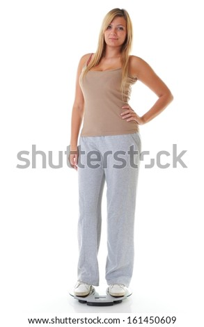 woman plus size large girl on weight scale measuring her weight controlling her dieting results, studio shot isolated on white - stock photo