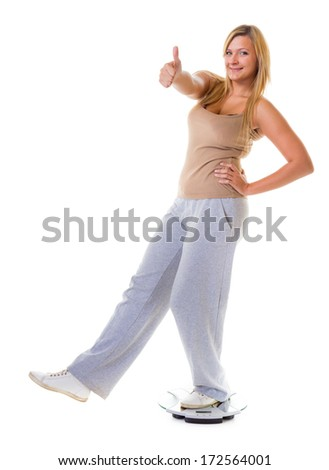 Woman plus size large happy girl with weight scale celebrating weightloss progress after diet, thumb up gesture ok sign, she lost some weight. Healthy lifestyles concept - stock photo