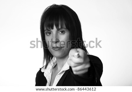 woman point out with a pen in her hand point at the viewer - stock photo