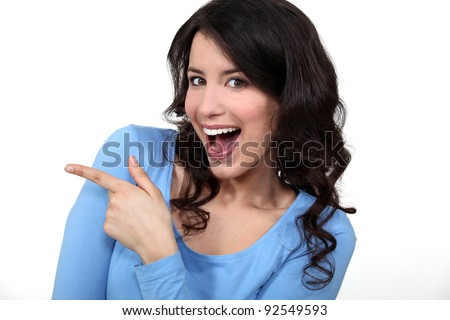 Woman pointing and laughing - stock photo