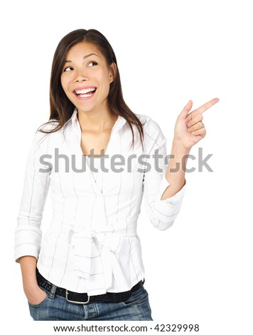 Woman pointing and looking to the side. Casual beautiful young mixed asian / caucasian woman happy and smiling. Isolated on white background. - stock photo