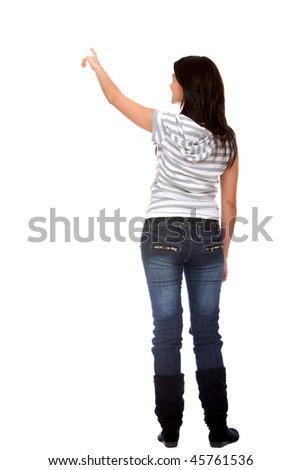 Woman pointing at something isolated over a white background - stock photo