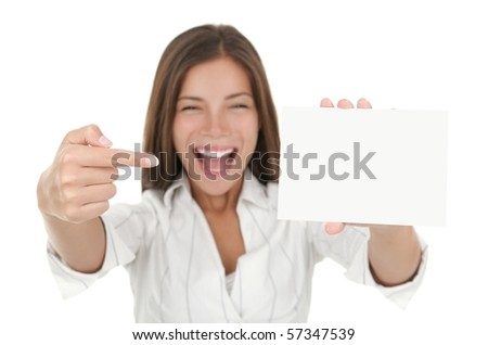 Woman pointing excited at blank card sign with copy space. Woman in white shirt isolated on white background - stock photo