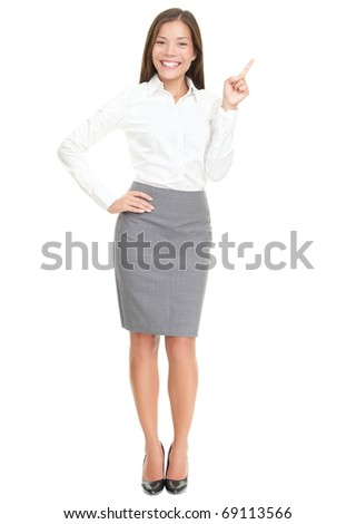 Woman pointing on white standing in full length. Caucasian / Asian woman smiling. Isolated over white background. - stock photo