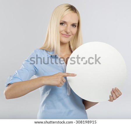 woman pointing to a blank board - stock photo