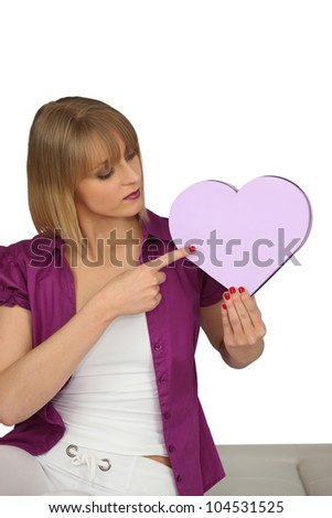 Woman pointing to a heart-shaped box - stock photo
