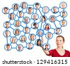 Woman pointing to people in social network and choosing one - stock photo