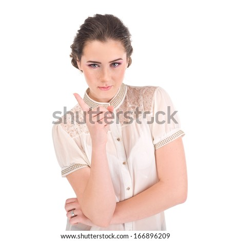Woman pointing up finger/ Studio shot portrait of one caucasian young woman nanny - stock photo