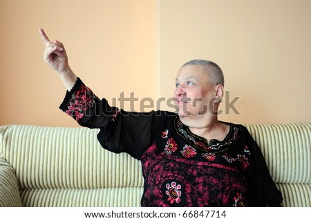 woman pointing with her finger - stock photo