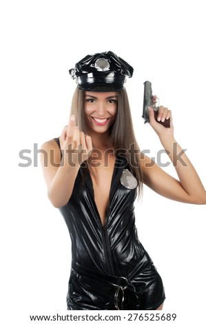 woman police officer with a pistol on an isolated background - stock photo