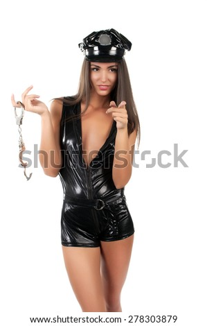 woman police officer with handcuffs on the offender shows - stock photo
