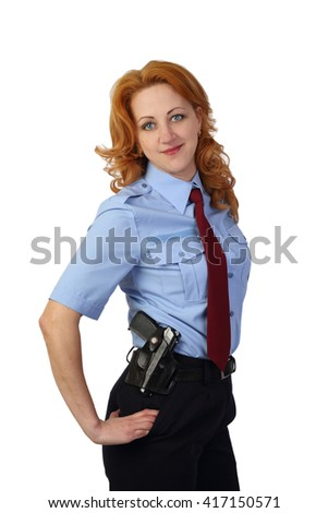 Woman police officer with pistol on hip smiles isolated on white background - stock photo