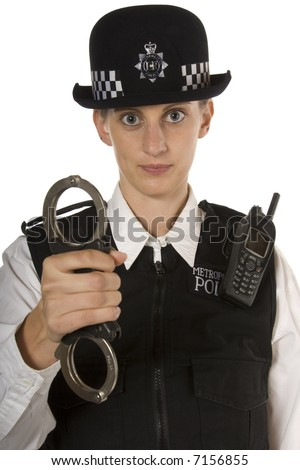 Woman Police officer with stern look showing handcuffs about to arrest someone isolated on white - stock photo