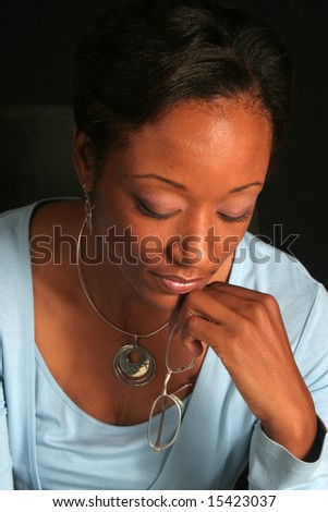 Woman pondering and considering - stock photo