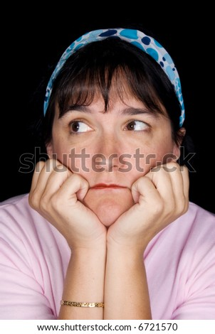 Woman pondering life.  She is set off by a blue hair wrap against a black background. - stock photo