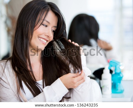 Woman portrait at the hair salon needing a haircut - stock photo