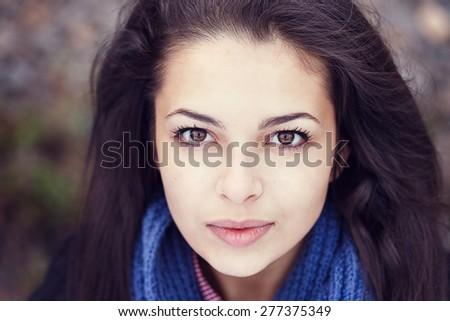 woman portrait blue scarf brunette - stock photo