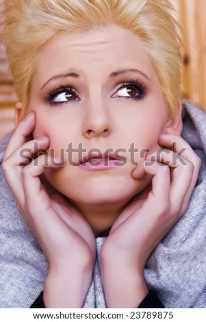 Woman portrait expressing afraid or worry - stock photo