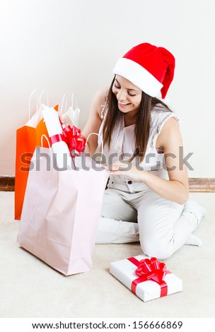 woman portrait hold christmas gift. smiling girl . shopping