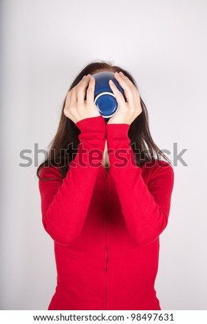 woman portrait holding a bowl in her hands - stock photo