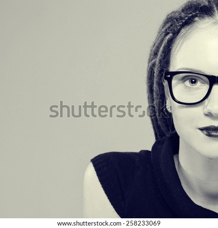 Woman portrait in glasses with dreadlocks black and white hipster - stock photo