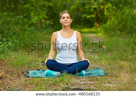 Woman portrait in yoga pose. Nature wood background.