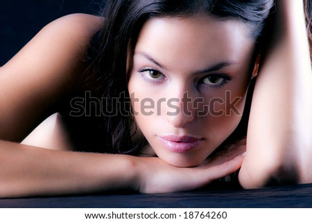 woman portrait, leaned on the hand - stock photo
