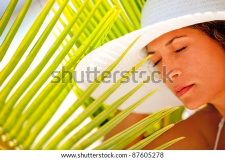 Woman portrait looking peaceful outdoors enjoying her vacations - stock photo