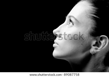 woman portrait on black background. studio shot, isolated. - stock photo