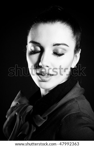 Woman portrait. On the black background.