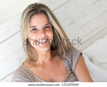 Woman portrait smiling at home looking very happy - stock photo