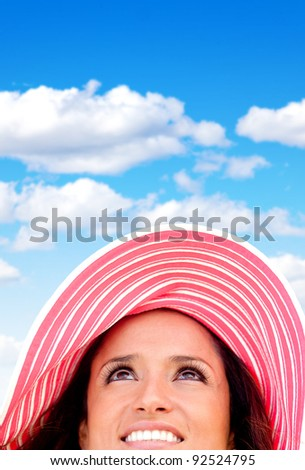 Woman portrait wearing a summery hat on a beautiful day - stock photo