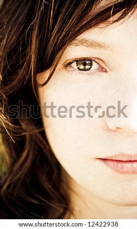 Woman portrait with  awesome eye. - stock photo