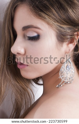 woman portrait with silver jewel side view - stock photo