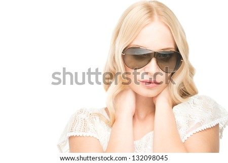 Woman posing at a camera isolated