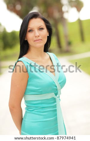 Woman posing in a blue dress