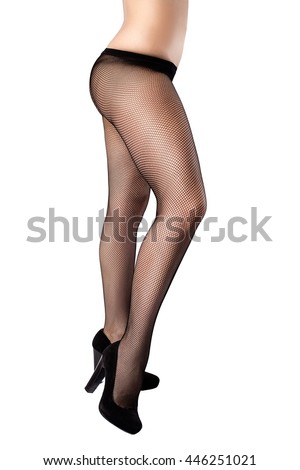 Woman posing in black pantyhose, and lingerie and heels isolated on the white background with shadows from the heels on the floor - side view - stock photo